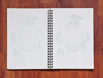 Open note book on wood background Stock Photo