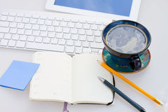 Open note pad  on working table Stock Photography