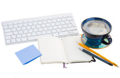 Open note pad  on working table on white Royalty Free Stock Images