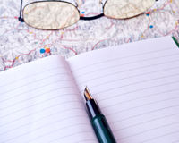 Open notebook. Notebook on a map, plannign your holidays Stock Photos