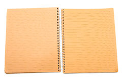 Open notebook. An open notebook with light brown paper stock photo
