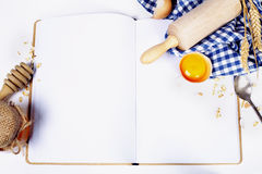Open Notebook And Basic Baking Ingredients Royalty Free Stock Photo