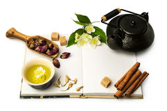 Open notebook and Asian tea set Stock Photos