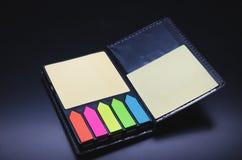 Open notebook on a black background. Black notebook on a black background Stock Photo