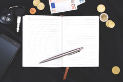 Open notebook on a black background Stock Photography