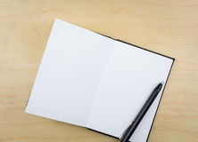 Open notebook with black pen Royalty Free Stock Photography