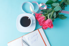 Open notebook with blank pages and bouquet of pink roses Royalty Free Stock Image