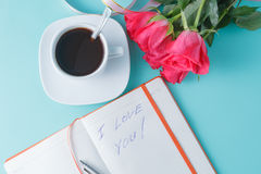 Open notebook with blank pages and bouquet of pink roses Royalty Free Stock Photo