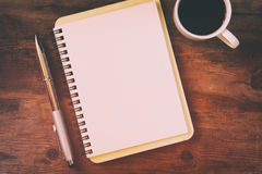 open notebook with blank pages next to cup of coffee Stock Photography