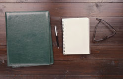 Open Notebook With Blank Pages, Pen, Leather Folder And Glasses Stock Image