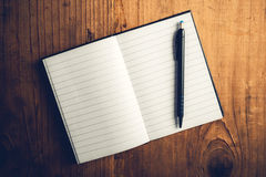 Open notebook with blank pages and pencil Royalty Free Stock Photo