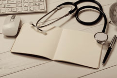 Open notebook with blank pages with stethoscope Stock Photos