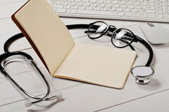 Open notebook with blank pages with a stethoscope Stock Photography