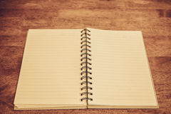 Open notebook blank pages on wooden table vintage style Royalty Free Stock Image