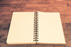 Open notebook blank pages on wooden table vintage style Royalty Free Stock Photography