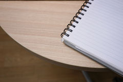 Open notebook with blank pages on the wooden table. Open notebook with blank white pages on the wooden table Royalty Free Stock Photos