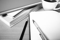 Open notebook with book and coffee cup  black and white color to Stock Image