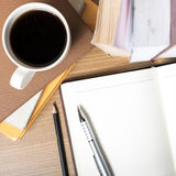 Open notebook with book and coffee cup royalty free stock image