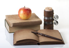 Open notebook and books Stock Image