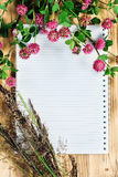 Open notebook, clover and herbs Royalty Free Stock Photography