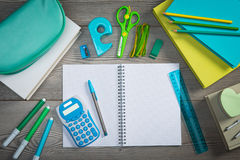 Open notebook with colorful stationery Royalty Free Stock Image