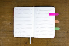 Open notebook with colorful tabs Stock Photos