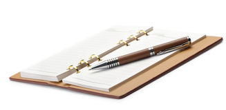Open notebook with copper binding and stylish pen Stock Image