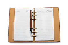 Open notebook with copper binding and stylish pen Royalty Free Stock Photos