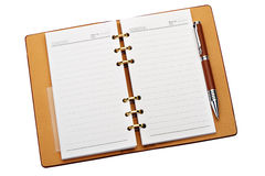 Open notebook with copper binding and stylish pen Royalty Free Stock Image