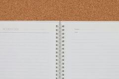Open notebook on cork board background Stock Photography