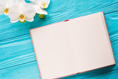 Open notebook with cup of coffee Royalty Free Stock Photography