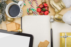 Open notebook with cup of coffee, cookies and ornaments. Royalty Free Stock Photos