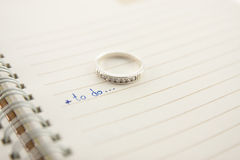Open notebook  and diamond ring...love concept Stock Image
