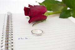 Open notebook  and diamond ring...valentin concept Stock Photography