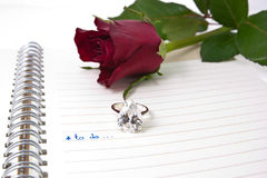 Open notebook  and diamond ring...valentin concept Royalty Free Stock Photos