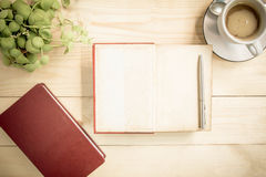 Open notebook diary on wooden table with coffee, Vintage Style Stock Photo