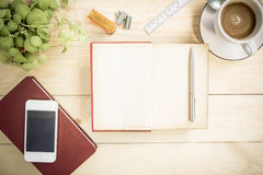 Open notebook diary on wooden table with coffee, Vintage Style. Stock Images