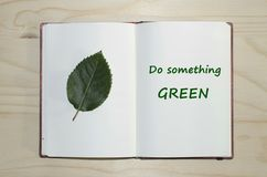 Open notebook with Do something green message Royalty Free Stock Image