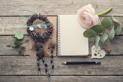 Open notebook, dream catcher and heart. Open notebook, dream catcher, heart and flower on shabby wooden table. Concept for journaling, dairy Royalty Free Stock Image