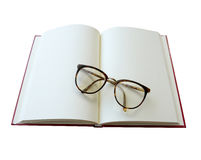 Open notebook and eyeglasses isolated on white. (clipping path) Royalty Free Stock Photos
