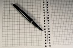 Open notebook with fountain pen royalty free stock photo