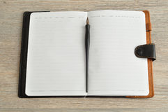 An open notebook with a fountain pen Stock Photos