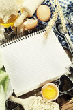 Open notebook and fresh ingredients Royalty Free Stock Photos