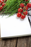 Open notebook and fresh vegetables Royalty Free Stock Images