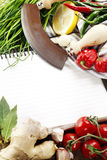 Open notebook and fresh vegetables Stock Photo