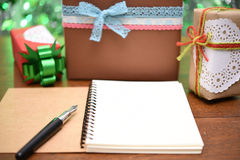 Open notebook and gift box Stock Image