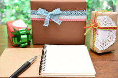 Open notebook and gift box Royalty Free Stock Photo