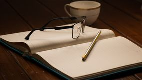 Notebook, Glasses , Pencil and Cup Stock Image