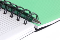 Open notebook and green pen 2. Open notebook with blank pages and with green pen, isolated on white background Royalty Free Stock Image
