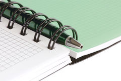 Open notebook with green pen stock images